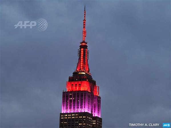 New York's Empire State Building Lit In Red & Purple