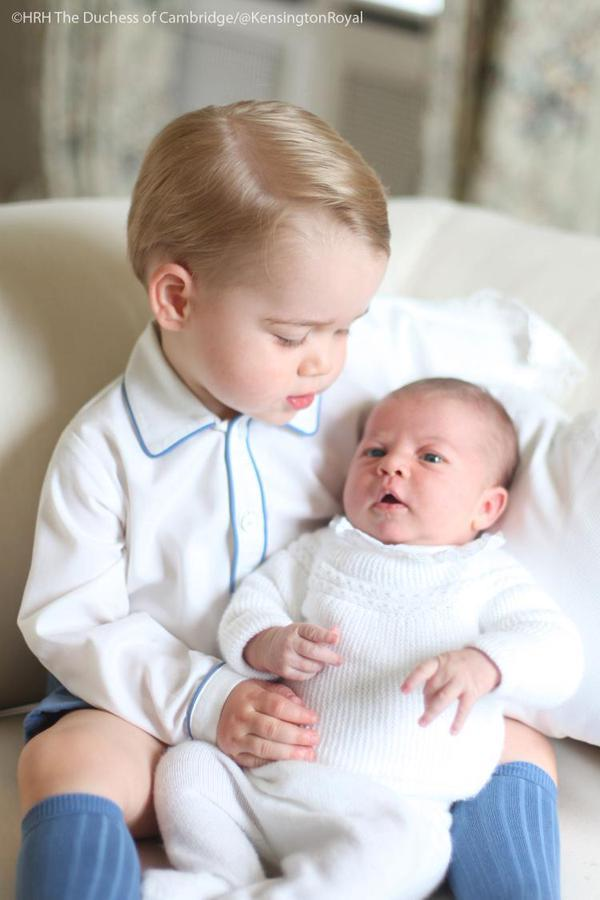 Prince George Carrying Baby Princess Charlotte