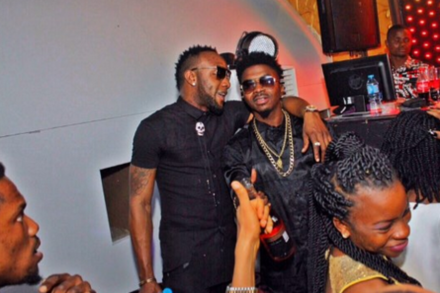 Skiibii sharing a moment with Kcee.  (Pulse.ng)