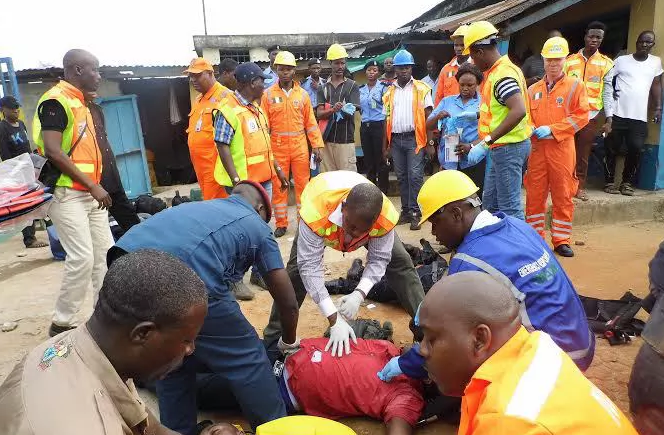 NEMA officials conducting rescue efforts at the scene of the crash