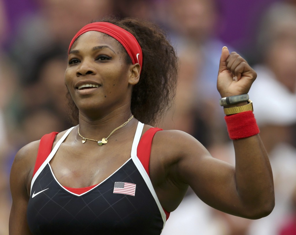 Serena Williams of the U.S. celebrates after defeating Russia's Vera Zvonareva in their women's singles tennis match at the All England Lawn Tennis Club during the London 2012 Olympic Games August 1, 2012. REUTERS/Sergio Moraes (BRITAIN - Tags: OLYMPICS SPORT TENNIS TPX IMAGES OF THE DAY)