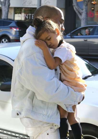 North and Kanye West passed out in the middle of shopping