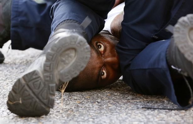 A protester pinned down