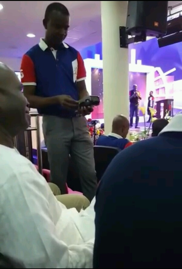 Church members paying tithes