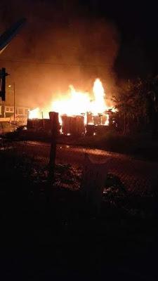 fire burns buildings