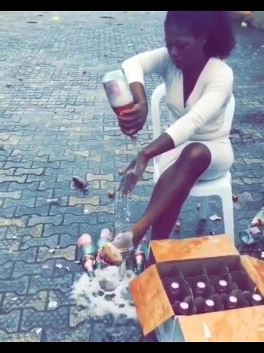 Slay queen pops 100 bottles