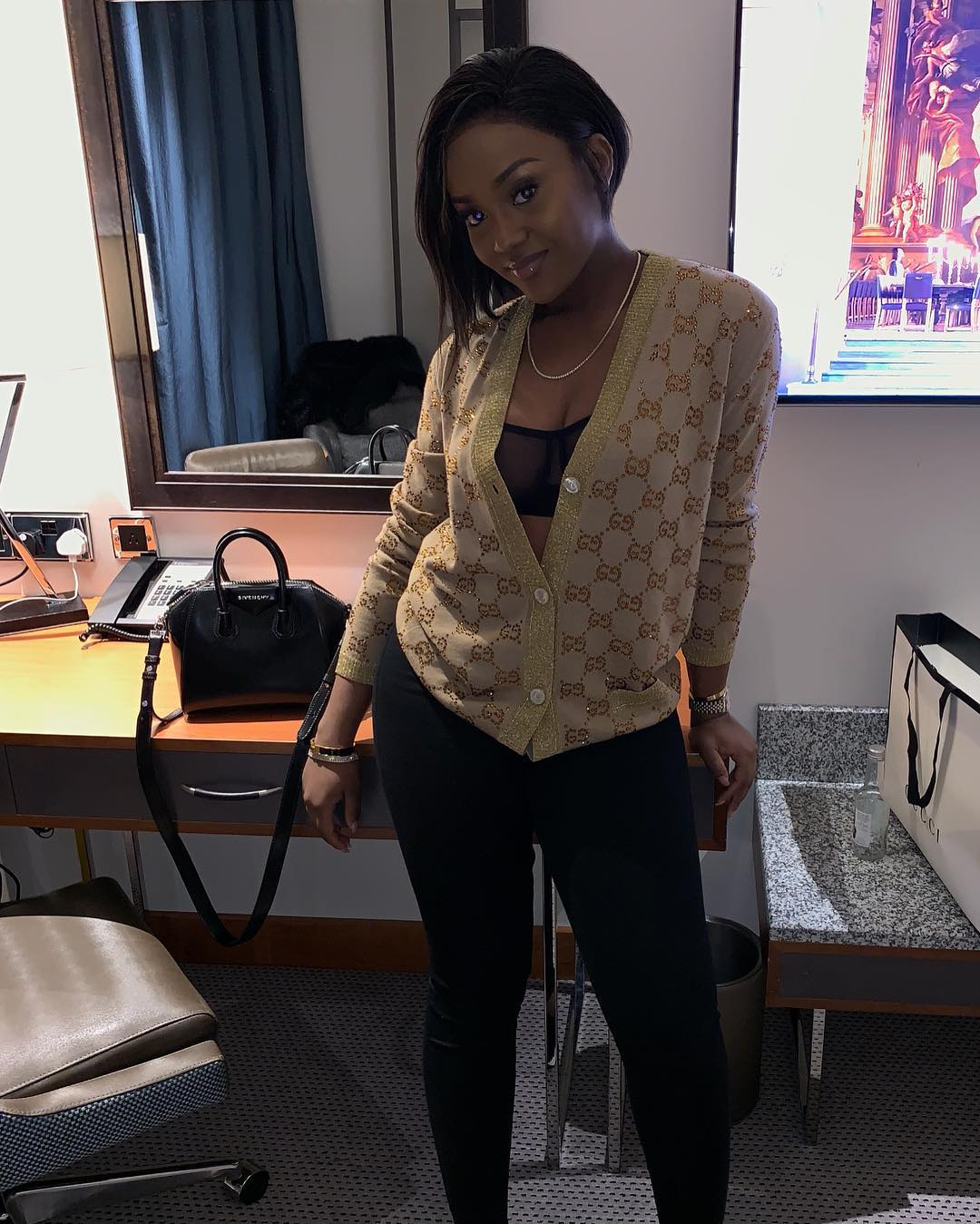 Chioma bares cleavage