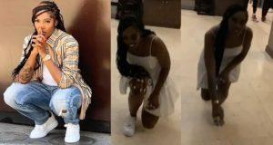 Tiwa Savage kneels