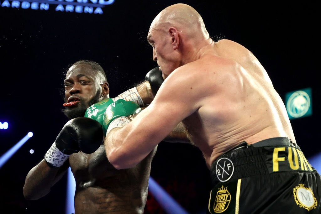 Image result for images of Deontay Wilder rushed to the hospital after brutal defeat to Tyson Fury