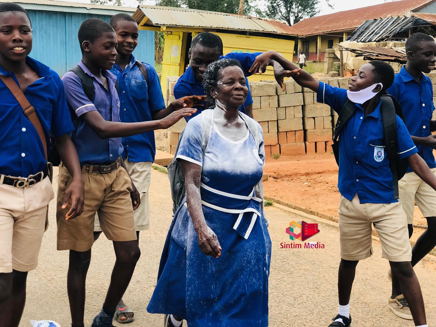 57 year old A 57-year-old woman jubilates as she completes her junior secondary education