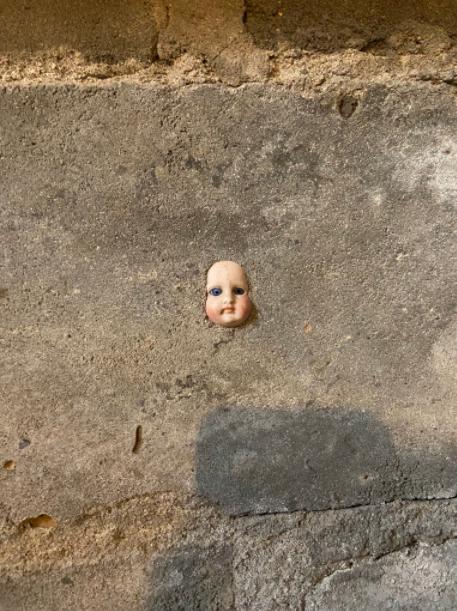 doll stuck basement