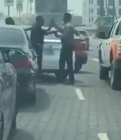 two grown men park