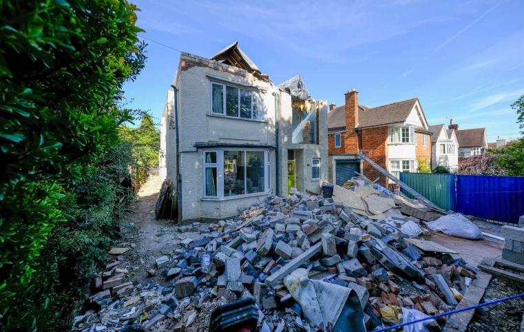 Builder breaks down house