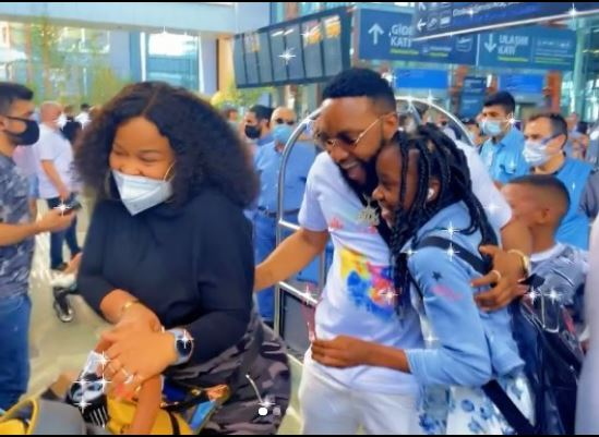 Kcee wife and children welcome him at the airport as he visits them in Turkey